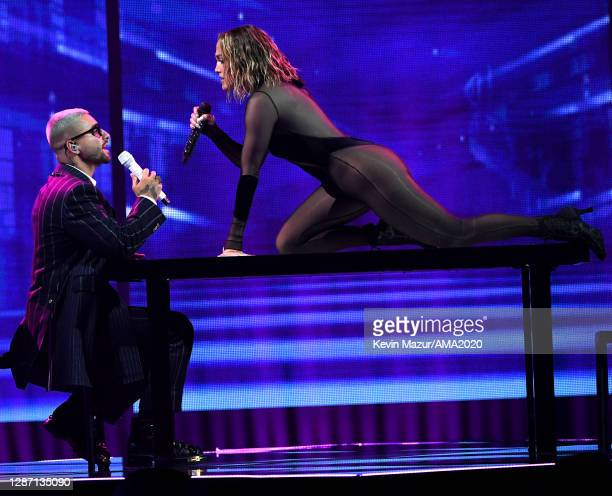 In this image released on November 22, Maluma and Jennifer Lopez perform onstage for the 2020 American Music Awards at Microsoft Theater on November...