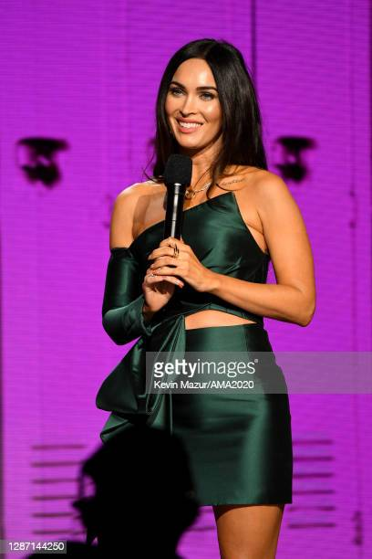 In this image released on November 22, Megan Fox speaks onstage for the 2020 American Music Awards at Microsoft Theater on November 22, 2020 in Los...