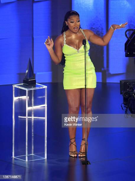 In this image released on November 22 Megan Thee Stallion accepts the award for Favorite Rap/HipHop Song onstage for the 2020 American Music Awards...