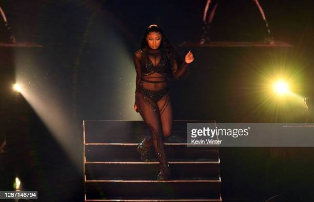 In this image released on November 22 Megan Thee Stallion performs onstage for the 2020 American Music Awards at Microsoft Theater on November 22...
