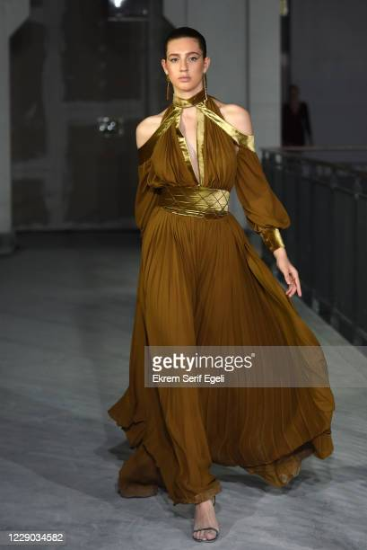 In this image released on October 12, A model walks the runway during the Tuba Ergin show during Mercedes-Benz Istanbul Fashion Week at Galataport...