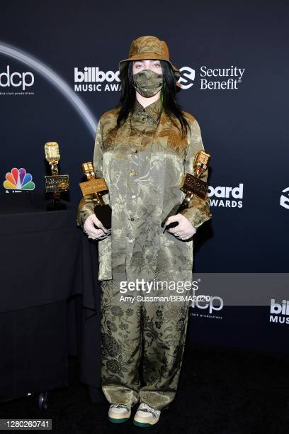 In this image released on October 14, Billie Eilish poses backstage at the 2020 Billboard Music Awards, broadcast on October 14, 2020 at the Dolby...