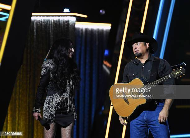 In this image released on October 14 Cher presents the Icon Award to Garth Brooks perform onstage at the 2020 Billboard Music Awards broadcast on...