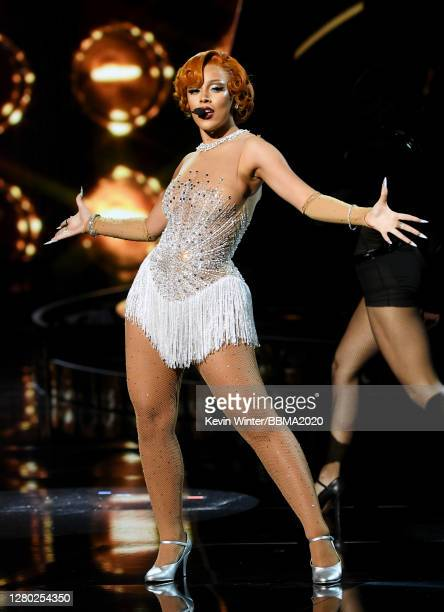 In this image released on October 14, Doja Cat performs onstage at the 2020 Billboard Music Awards, broadcast on October 14, 2020 at the Dolby...