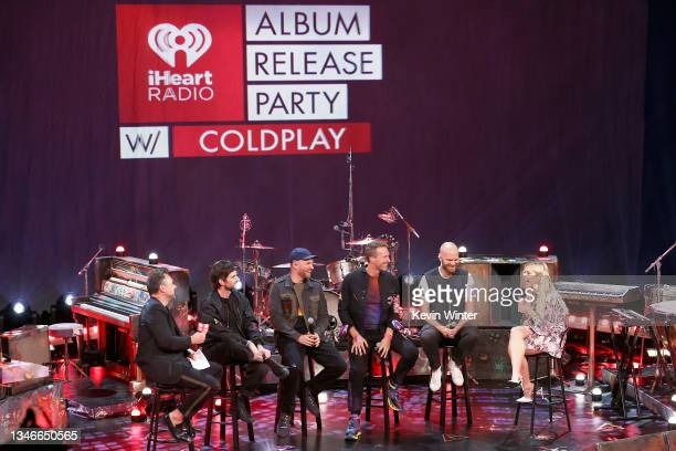 In this image released on October 14 Guy Berryman, Jonny Buckland, Chris Martin, and Will Champion of Coldplay speak with hosts Chris Booker and...