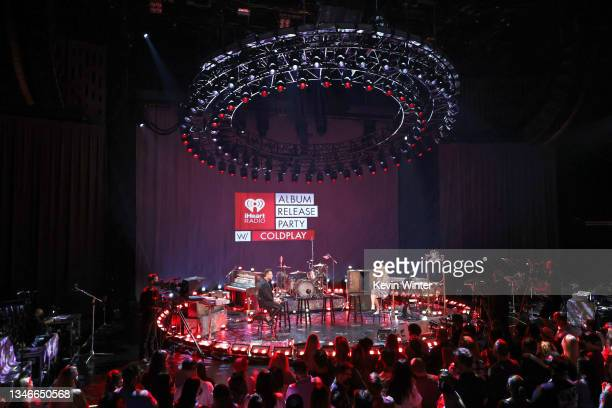 In this image released on October 14 Hosts Chris Booker and Tanya Rad speak onstage at the iHeartRadio Album Release Party with Coldplay at...