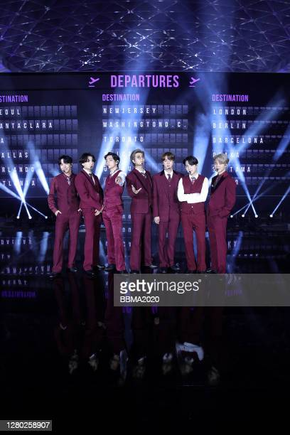 In this image released on October 14 JHope Jungkook V RM Jin Suga and Jimin of BTS perform onstage at the 2020 Billboard Music Awards broadcast on...