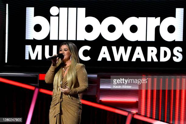 In this image released on October 14, Kelly Clarkson speaks onstage at the 2020 Billboard Music Awards, broadcast on October 14, 2020 at the Dolby...