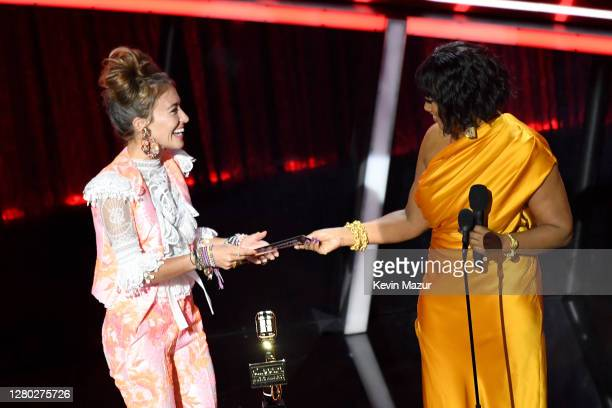 In this image released on October 14 Lauren Daigle accepts the Top Christian Artist Award from Garcelle Beauvais onstage at the 2020 Billboard Music...