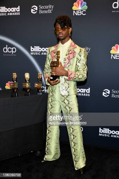 In this image released on October 14, Lil Nas X poses backstage at the 2020 Billboard Music Awards, broadcast on October 14, 2020 at the Dolby...