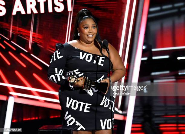 In this image released on October 14, Lizzo accepts the Top Song Sales Artist Award onstage at the 2020 Billboard Music Awards, broadcast on October...