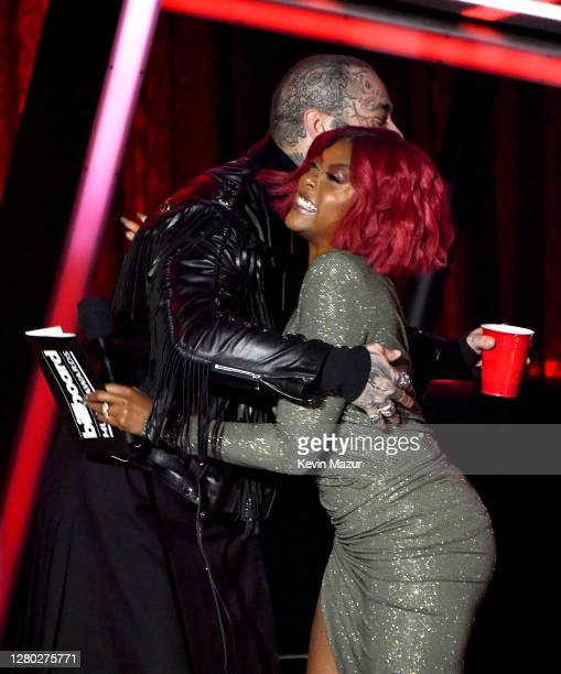 In this image released on October 14 Post Malone accepts the Top Artist Award from Taraji P Henson onstage at the 2020 Billboard Music Awards...