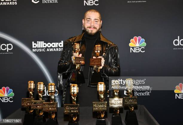 In this image released on October 14, Post Malone poses backstage at the 2020 Billboard Music Awards, broadcast on October 14, 2020 at the Dolby...