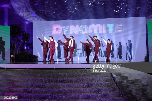 In this image released on October 14, RM, V, Jimin, Jungkook, Jin, J-Hope, and Suga of BTS perform onstage at the 2020 Billboard Music Awards,...