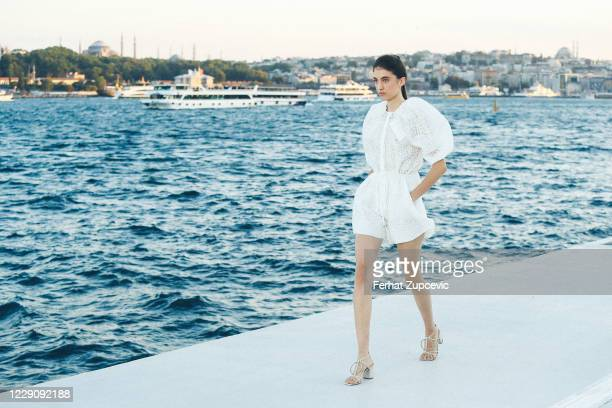 In this image released on October 15, A model walks the runway during the Özgür Masur show during Mercedes-Benz Istanbul Fashion Week at Galataport...