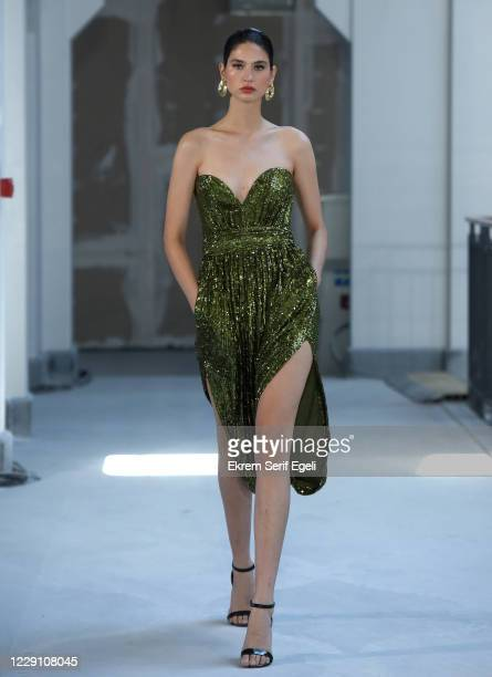 In this image released on October 16, A model walks the runway during the Museum of Fine Clothing show during Mercedes-Benz Istanbul Fashion Week at...