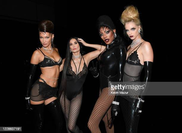 In this image released on October 2, Bella Hadid, Demi Moore, Jaida Essence Hall, and Abby Champion are seen backstage during Rihanna's Savage X...