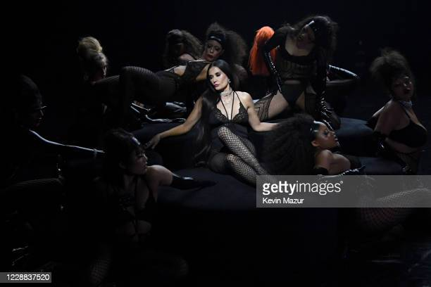 In this image released on October 2, Jaida Essence Hall, Abby Champion, Demi Moore, and Precious Lee are seen onstage during Rihanna's Savage X Fenty...