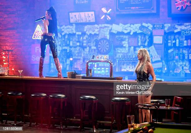 In this image released on October 21 Kelsea Ballerini and Halsey perform onstage for the 2020 CMT Awards broadcast on Wednesday October 21 2020