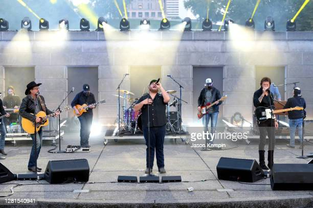 In this image released on October 21 Luke Combs performs with Kix Brooks and Ronnie Dunn of Brooks Dunn onstage at Bicentennial Mall in Nashville...