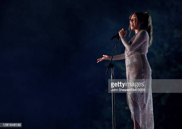 In this image released on October 21 Mickey Guyton performs onstage at the Sycamore Barn in Arrington Tennessee for the 2020 CMT Awards broadcast on...