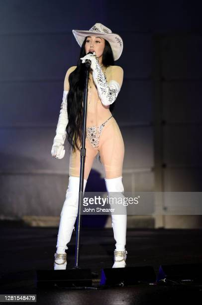 In this image released on October 21, Noah Cyrus performs onstage at the Bicentennial Mall in Nashville, Tennessee for the 2020 CMT Awards, broadcast...