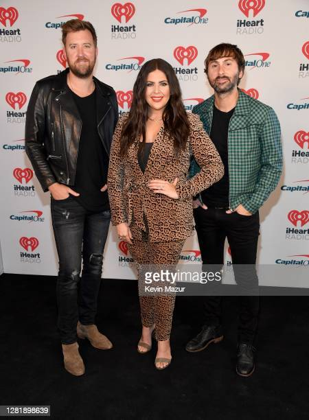 In this image released on October 23 Charles Kelley Hillary Scott and Dave Haywood of Lady A pose backstage for the 2020 iHeartCountry Festival...