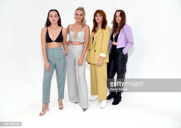In this image released on October 23 Savana Santos Kelsea Ballerini Sami Bearden and Samantha Backoff pose for a portrait for the 2020 iHeartCountry...
