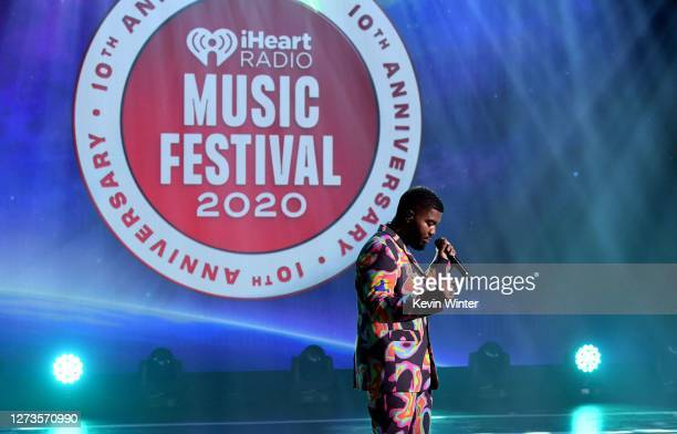 In this image released on September 19, Khalid performs onstage for the 10th Anniversary of the iHeartRadio Music Festival streaming on CWTV.com and...