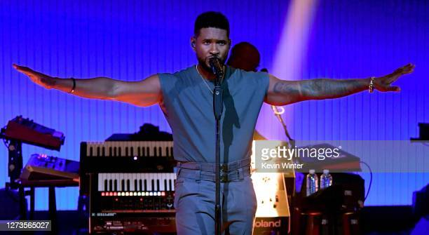 In this image released on September 19, Usher performs onstage for the 10th Anniversary of the iHeartRadio Music Festival streaming on CWTV.com and...