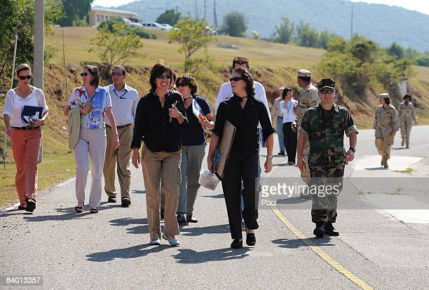 In this Image reviewed by the US military US Navy Commander Jeffrey Gordon escorts journalist attending a pretrial session for Omar Khadr a...