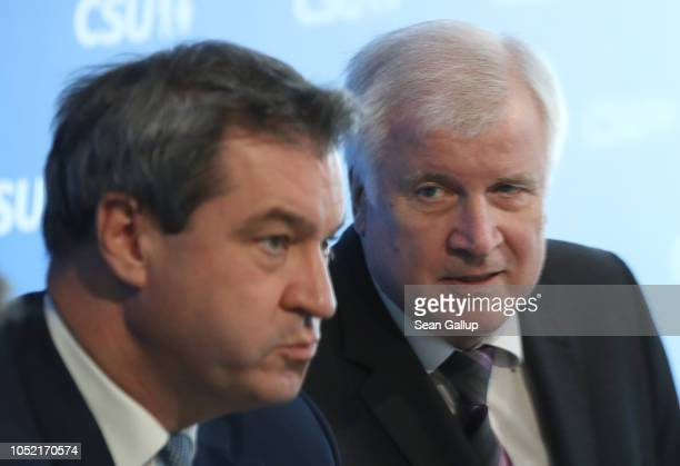 In this image shot through a pain of glass Horst Seehofer Chairman of the Christian Social Union and Markus Soeder Governor of Bavaria and lead...