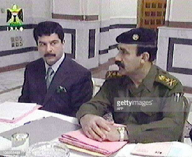 In this image taken off Iraqi television Qusay one of the sons of Iraqi President Saddam Hussein sits with the president's personal secretary Abed...