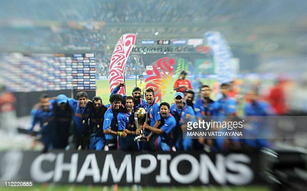 In this image taken with a Tilt and Shift Lens Indian cricketers celebrate with the trophy after beating Sri Lanka in the ICC Cricket World Cup 2011...
