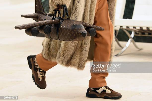 In this images relesead juanuary 21, model walks the runway during the Louis Vuitton Menswear Fall/ 2021-2022 show as part of Paris Fashion Week on...