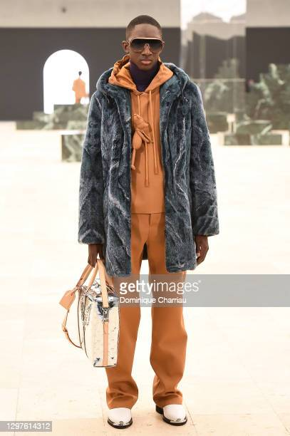In this images relesead juanuary 21, model walks the runway during the Louis Vuitton Menswear Fall/Winter 2021-2022 show as part of Paris Fashion...