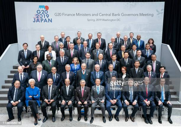 In this IMF handout the G20 Finance Ministers and Central Bank Governors pose for a formal family photo at IMF Headquarters during the 2019 IMF/World...