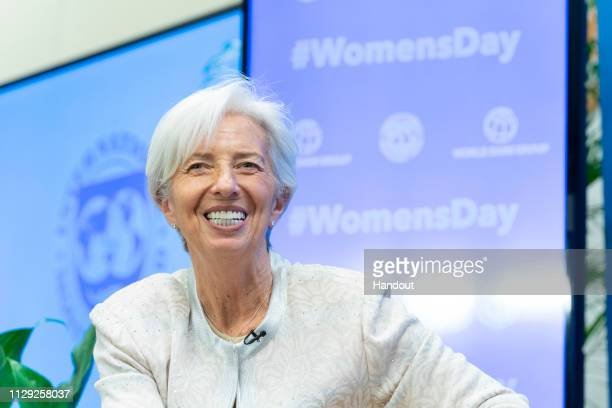 In this International Monetary Fund handout International Monetary Fund Managing Director Christine Lagarde is joined by the Interim World Bank...