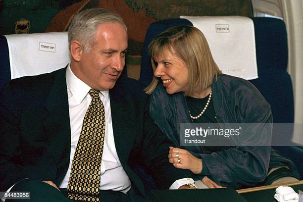 In this Israeli Government Press Office file photo Prime Minister Benjamin Netanyahu and his wife Sara Netanyahu on board an Israeli Air Force jet en...
