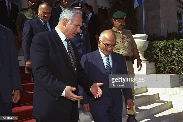 In this Israeli Government Press Office file photo, visiting Israeli Prime Minister Benjamin Netanyahu talks with his host King Hussein on the steps...