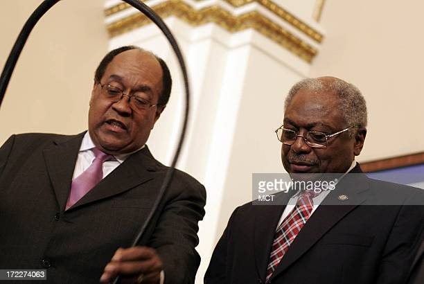 In this January 4 2007 file photograph House Majority Whip Rep Jim Clyburn right receives a whip from William Gray in Clyburn's new office in...