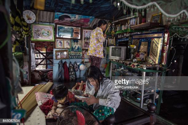 In this July 17 2017 photograph Nguyen Kim Truong who makes a living by selling food and drinks in a canal off the Song Hau river in the floating Cai...