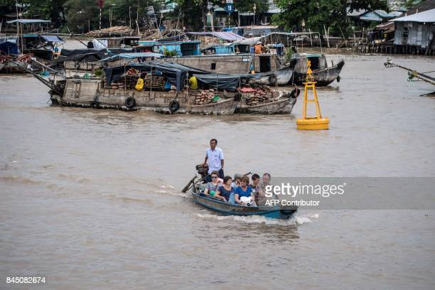In this July 17, 2017 photograph, tourists ride a boat in a canal off the Song Hau river in the floating Cai Rang market in Can Tho, a small city of...