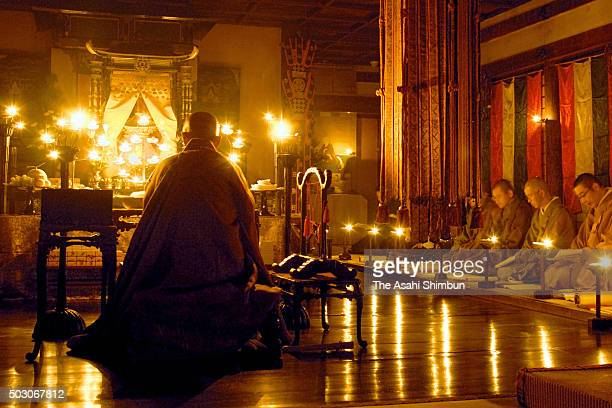 In this long exposure image Buddhist monks chant sutra to commemorate Buddha at Toshodaiji Temple on October 21 2006 in Nara Japan