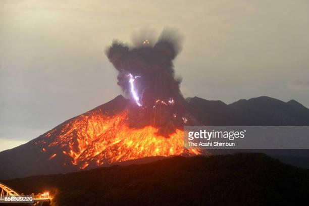 In this long exposure image Mt Sakurajima erupts on October 1 2017 in Tarumizu Kagoshima Japan