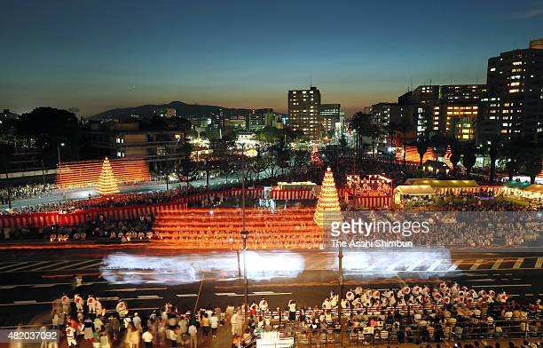 In this long exposure image shinto parishioners carry 10metertall 25ton 'Chochin O Yamagasa' or candlelit lantern floats during the Tobata Gion...