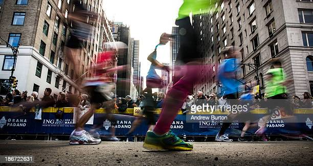 In this long exposure photograph runners participate in the ING New York City Marathon on November 3 2013 in New York City With the Boston Marathon...