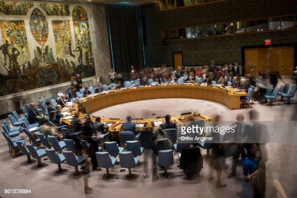 In this long exposure photograph the United Nations Security Council meets concerning the situation in the Middle East at UN headquarters April 26...