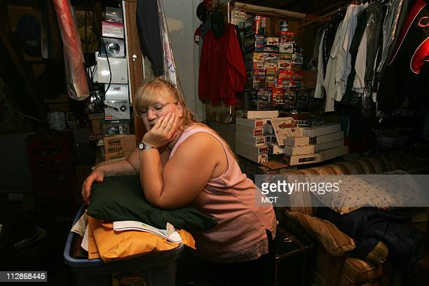 In this March 16 2006 file photograph Charlene Darnell rests in the basement the most organized room in their home which houses her husband's music...