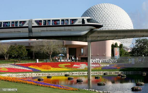 In this March 19, 2009 file photo, a Disney World monorail passes Spaceship Earth at Walt Disney World's Epcot Center in Lake Buena Vista, Fla....